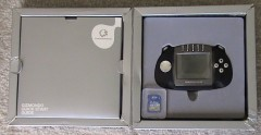 Silver Gizmondo unit in box with intruction pack showing