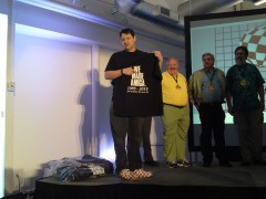 Bill Borsari presents the Amiga team with their event shirts